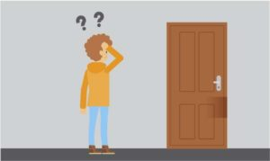 homme se demandant comment ouvrir une porte claquée
